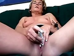 Slim milf stripps and caresses clit
