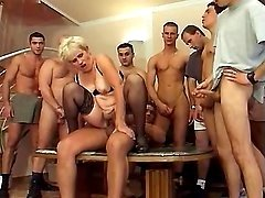 Mom gets jizz in gangbang
